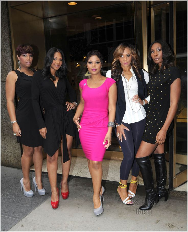 """The Braxtons November 12, 2012-----Toni """"The"""" Braxton in fuchsia pink dress and grey platforms, Tamar in white dress shirt and navy vest and leggings, Tracy/Trina/Towanda in black dresses"""