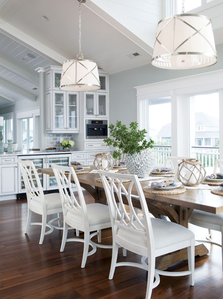 Beach Style Dining Room With Two Pendant Lights Hanging Above Long Rectangular Table