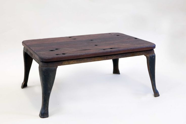 Railway sleepers on an old coal stove base make this beautiful rustic outdoor coffee table.