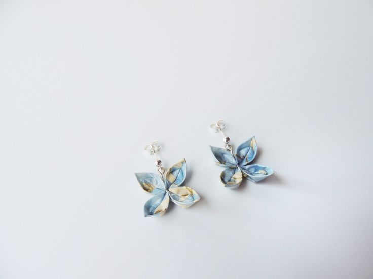 Small handmade origami flower earrings in pastel blue, cream and flecks of gold, with sterling silver fittings.