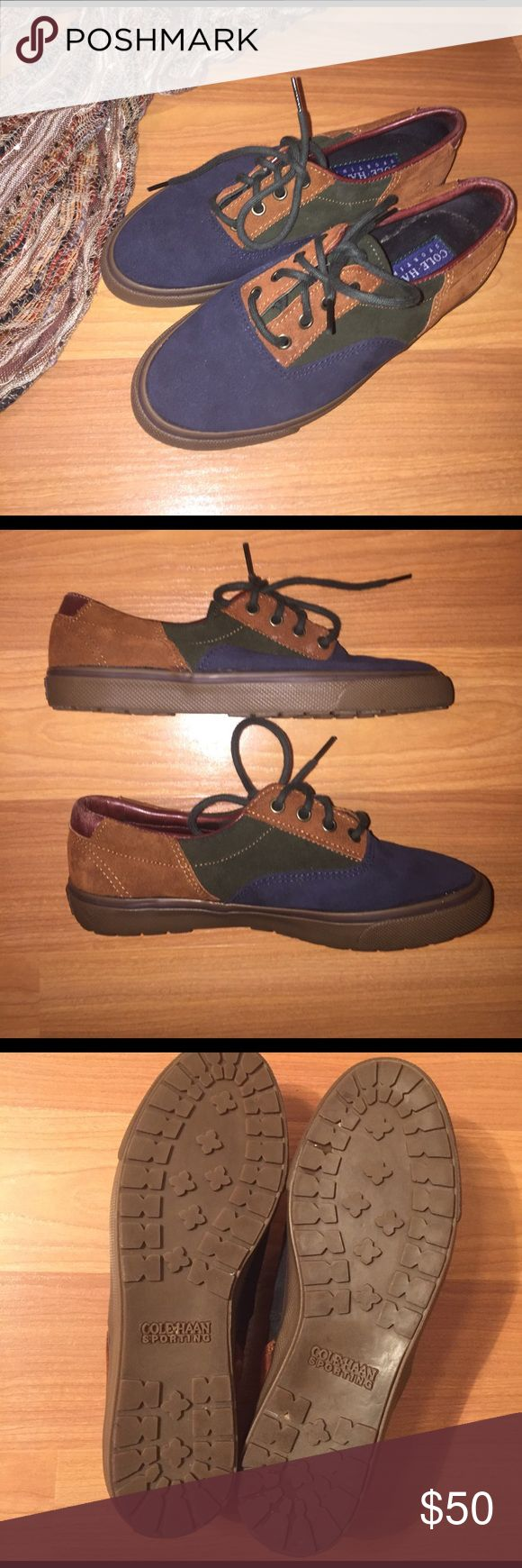 Cole Haan Sporting Lace-ups Only worn once. Brand: Cole Haan. These lace-up tennis shoes are a great casual shoe. Suede leather upper in Navy, forest green, and cognac . Forest green laces. Leather accents on heels and near opening of shoe. Good grip soles. Materials are in near perfect condition. Soles show minimal wear. Please let me know if you'd like an extra pic. Accessories not included. Please let me know if you have any questions. Thanks for looking! Cole Haan Shoes