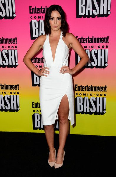 Chloe Bennet Halter Dress - Chloe Bennet flashed some cleavage and thigh in a white high-slit halter dress at the Entertainment Weekly Comic-Con party.