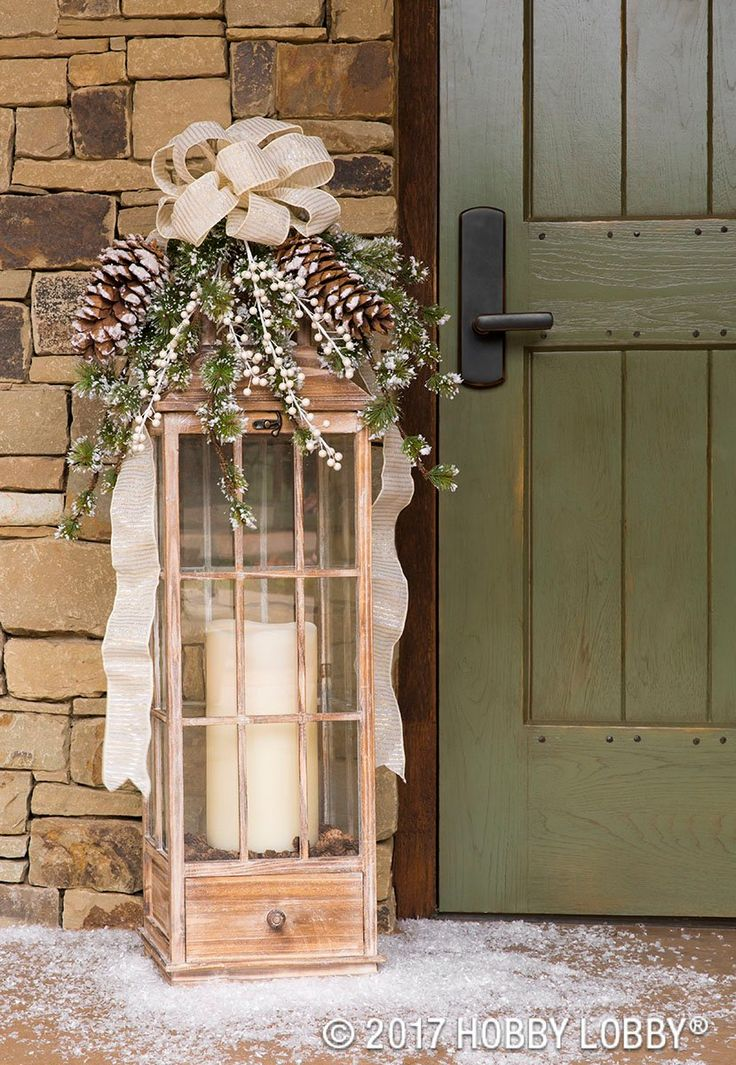 Turn outdoor lanterns into a winter focal piece with Christmas foliage! Just use floral wire to secure Christmas picks into the lantern's handle.