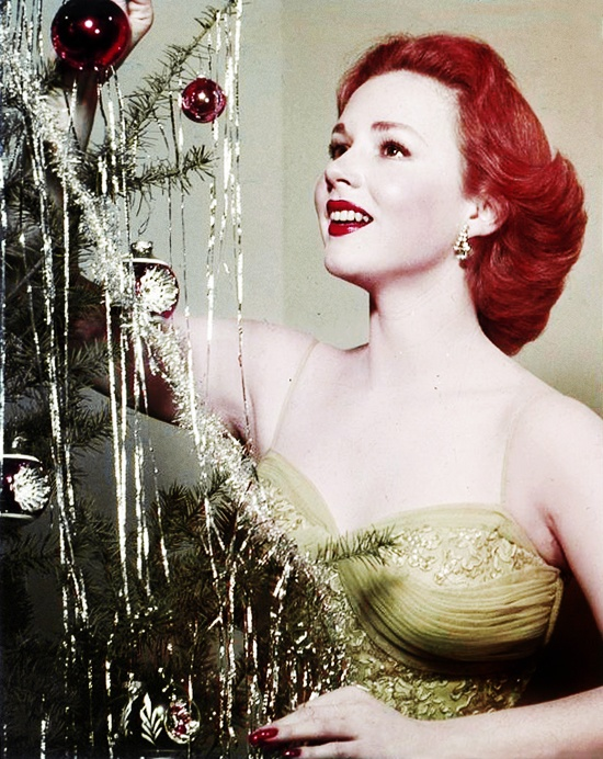 Piper Laurie decorating the tree circa 1950