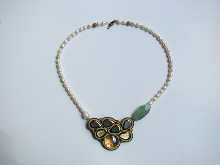 Necklace made of fresh water pearl, Semi-precious stones,glass, natural leather, nickel-free metal and gold foil. www.iasoltanei.ro