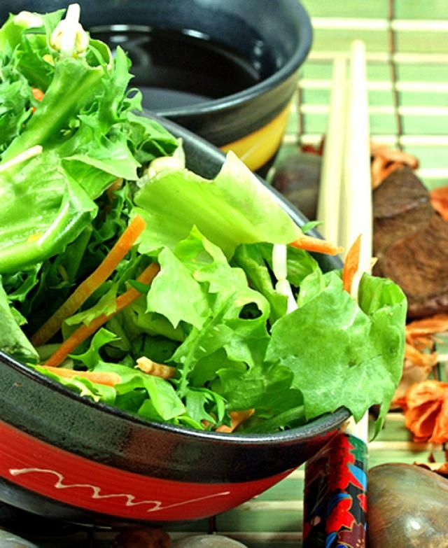 This easy Thai tossed green salad recipe can be put together in a matter of minutes. Salad makes a wonderfully cooling side dish to spicy Thai curries and other Thai recipes, but is equally excellent with everyday meals. This tossed salad includes a very simple salad dressing recipe that's deliciously creamy but also low in fat and calories. Tip: Double the salad dressing recipe and keep any extra in the refrigerator for a quick tossed salad anytime!