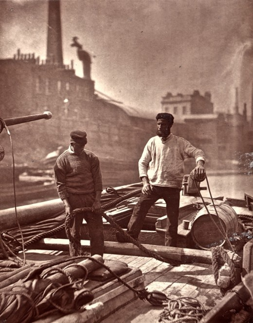 Life on the Thames, or as photographer John Thomson called it in 1876, the 'Silent Highway. Two sailors head down the river in a barge