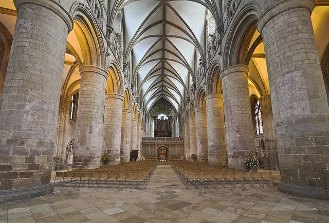 """In Britain, the Romanesque style became known as """"Norman"""" because the major building scheme in the 11th and 12th centuries was instigated by William the Conqueror, who invaded Britain in 1066 from Normandy in northern France. Gloucester Cathedral is an excellent example of churches in the Norman, or Romanesque style.   Gloucester Cathedral, nave, photo: Michael D. Beckwith (CC BY 2.0)"""