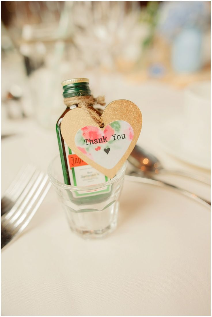 Miniature bottles of Jägermeister - Image by Kerrie Mitchell - Pastel Wedding With Shabby Chic Styling At Gaynes Park With Bride In Lace Fishtail Sarah Janks Gown With Groom In Powder Blue Bowtie From Mrs Bowtie And Images By Kerrie Mitchell