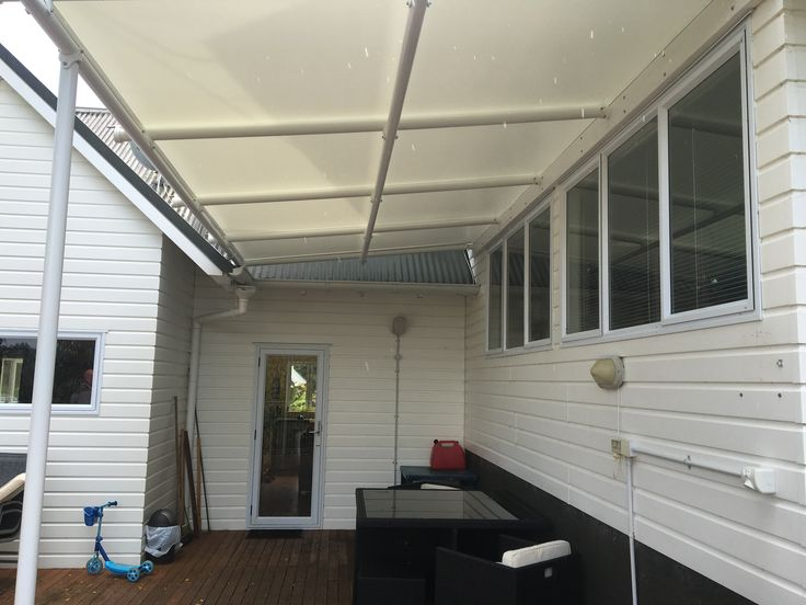 Triax is an outdoor shade system with a skin as tight as a drum.  This one has been done in white, Ferrari 702 S.