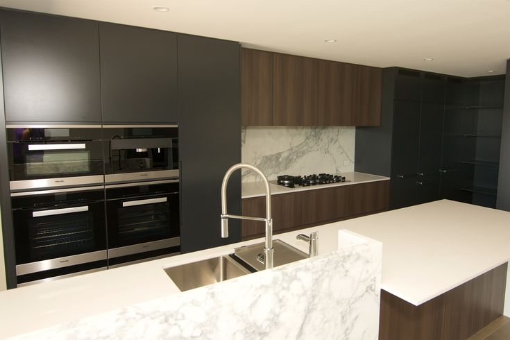 Stunning Apartment kitchen with an amazing splashback that ties in perfectly with the island bench!