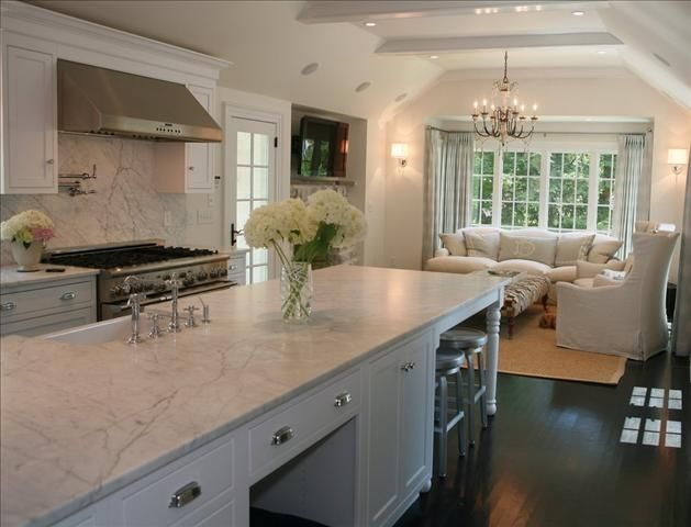 kitchen with tv nook; marble backsplash; dark wood floors