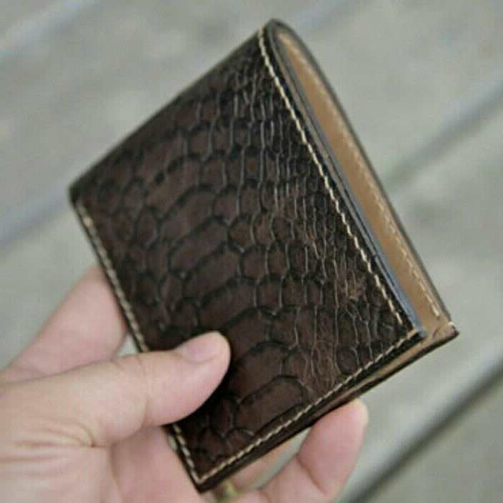 A combination of python print leather with distressed leather reveals bifold wallet. 100 %hand crafted at our atelier