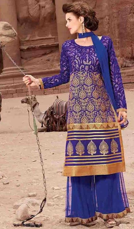 Gorgeously mesmerizing is what you will look at the next social function as you wear this blue color embroidered georgette palazzo suit. This attire is nicely created with lace and resham work. #georgettepalazzodress #bluecolordresses #embroideredpalazzosuit