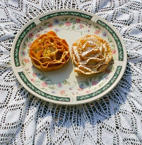 Caragnoli (Rose wheels Christmas fritters). My Nana Ross made these and were my favorite as a little girl. HAVE to try them and introduce them to my Little girl.
