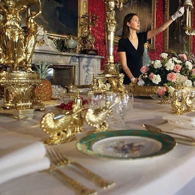 The State Dining Room in Buckingham Palace - the table set as for a dinner in readiness for the annual public tours ... The room was completed by Edward Blore in 1834 for William IV but the decorating continued into the early years of Queen Victoria's reign.  Green Sevres' French Porcelain