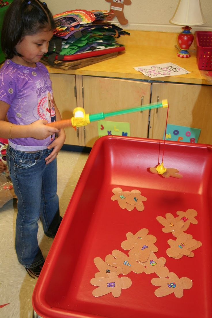 """Mrs. Lee's Kindergarten: They had to """"catch"""" gingerbread men here and find the matching letter and dot it with a bingo dotter.  For fellow teachers who may be reading this...after paper-clipping all of those ginger people last year and the clips falling off after every """"catch"""", I had the idea of just stapling a staple in each one.  It worked just as well and so much easier than paper clips."""