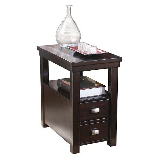 Clean lines and chic style make the Hatsuko chairside end table a standout piece. Dark finish pairs nicely with brushed-nickel-tone hardware, while lower shelf offers ample display space. Stow remotes, magazines and more in one of table's two drawers.   Signature Design by Ashley is a registered trademark of Ashley Furniture Industries, Inc.