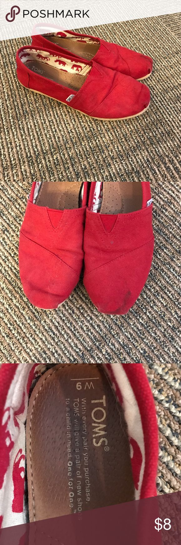 TOMS Worn Red TOMS.  Broken in, worn, small black stain on tip of left shoe TOMS Shoes Flats & Loafers