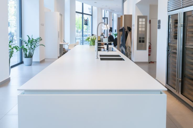 White, shiny…. this island by Poggenpohl with Dekton Zenith countertops is ideal for a minimalist design #kitchen.