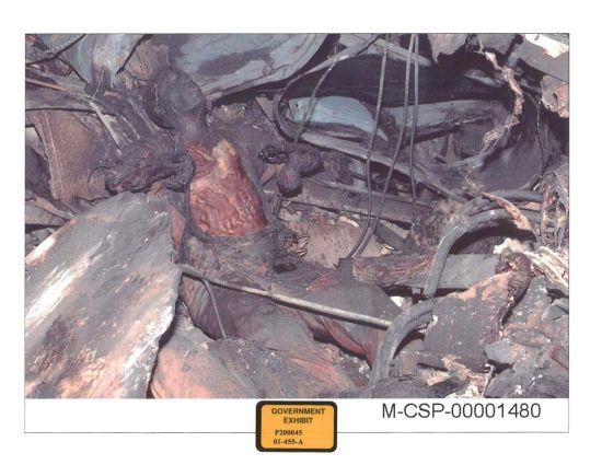 WARNING GRAPHIC: Victim in a seated position in the pentagon rubble - evidence of explosives and NOT jet fuel