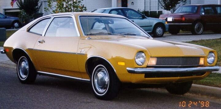 Ford Pinto.  First car I ever owned was a Ford Pinto, white with hatchback.  It was a piece of crap, but I thought it was so badass!