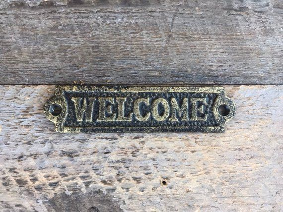 Small Cast Iron Welcome Sign Lightly Brushed In Gold Hang On Any Surface Welcomesign Castironwelcomesign Metal Welcome Sign Welcome Sign It Cast