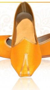 Exclusive yellow handmade wedding mens mojri intricate with raw silk fabric. Synthetic leather lining inside and a rubber sole. Heel height: 0.2 inches...