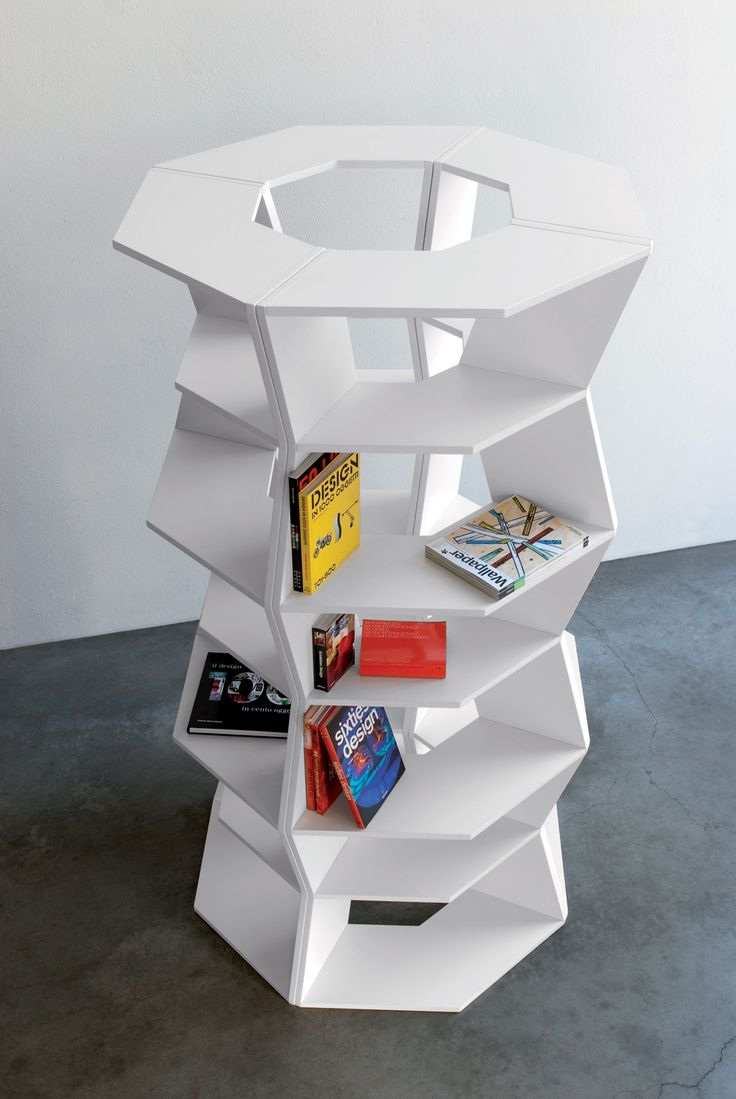 ZIG ZAG, modular bookcase with edless different furnishing solutions in micro embossed, white lacquered MDF board..design by Aziz Sariyer in 2009.