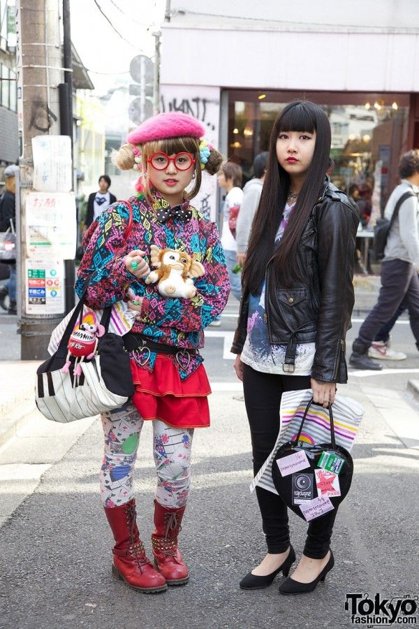 We ran into these two friendly Japanese girls (and one friendly Gremlin) walking down the street in Harajuku. On the left is the exceptionally-colorful Matsuko, 17-years old. On the right is 19-year-old Ayuki. Ayuki is wearing a simple-but-cute outfit consisting of a leather biker jacket from Hanjiro (a resale shop in Harajuku) over a graphic t-shirt that she received as a gift, skinny jeans from Moussy, and low black heels. Her accessories include a zipper choker from Claire's and a black…
