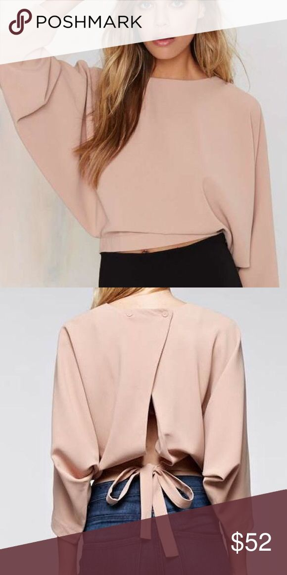 Nude batwing blouse NEVER WORN, perfect condition, super cute 📦 SAME DAY PACKAGING 📫 NEXT DAY SHIPPING 🔵 USE THE OFFER BUTTON 👛 ASK FOR BUNDLES! 🚫 NO TRADES Nasty Gal Tops Blouses