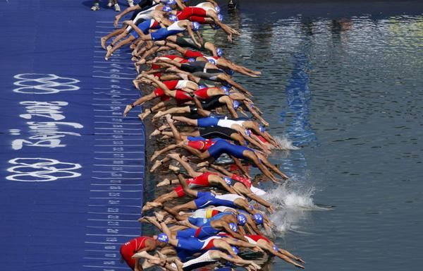 Get it! Competitors start the swim portion of the men's triathlon competition at the Ming Tomb reservoir in the Changping District of northern Beijing during the Beijing 2008 Olympic Games