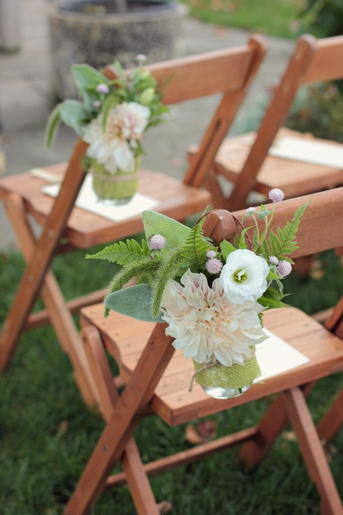 Simple jars like this for your tables.  We could make them so they hang on the aisle chairs like this too if you want.