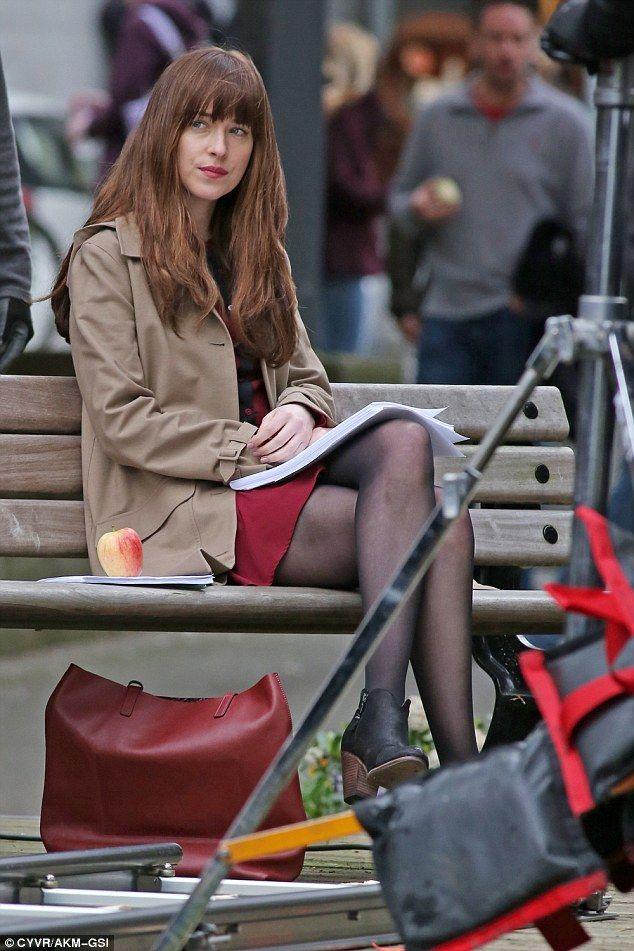 Leggy: Dakota was flaunting her incredible legs as she saw shooting go underway...
