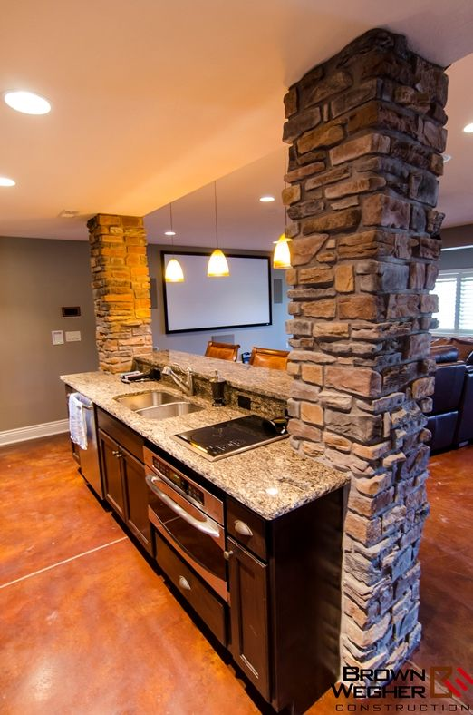 This basement bar/kitchen complete with wet bar and home theatre, built exclusively by Brown Wegher.