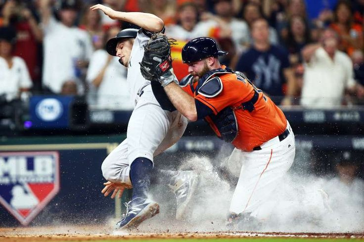 Best images of 2017 MLB playoffs -  BIRD IS OUT:   The Yankees' Greg Bird is tagged out at home plate by the Astros' Brian McCann on Oct. 13 in Houston. The Astros won 2-1.