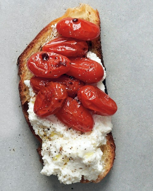 Roasted Tomato and Ricotta Crostini  Ingredients:  3 tablespoons extra-virgin olive oil  2 pints grape tomatoes  Coarse salt and ground pepper  2 cups ricotta cheese  Balsamic vinegar