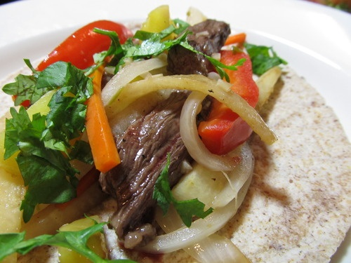 ... steak, thinly sliced Salt and black pepper 1 large onion, halved and