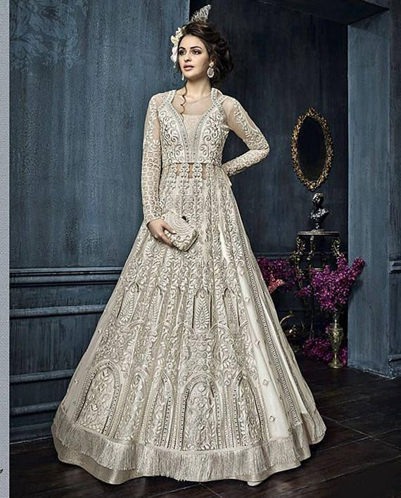 Designer Long Anarkali Suit with floral embroidery work with Resham thread work all over and yoke. The Anarkali top is semi stitched. This product consists of semi stitched top, bottom and dupatta. This can be stitched using the custom tailoring. Designs, colours and patterns.  This is an