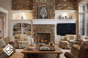 Checkout this cozy sitting area off the kitchen. Love the beautiful built in cabinets with the stonework. #yesplease #handcraftedcabinets #cozy