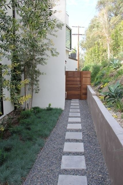 Beautiful horizontal fence + gravel + square pavers