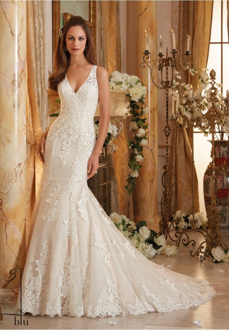 Wedding Gowns By Blu featuring Frosted Beading on Embroidered Appliques and Wide Hemline onto Soft Net Available in Three Lengths: 55', 58', 61'. Colors Available: White, Ivory, Ivory/Light Gold