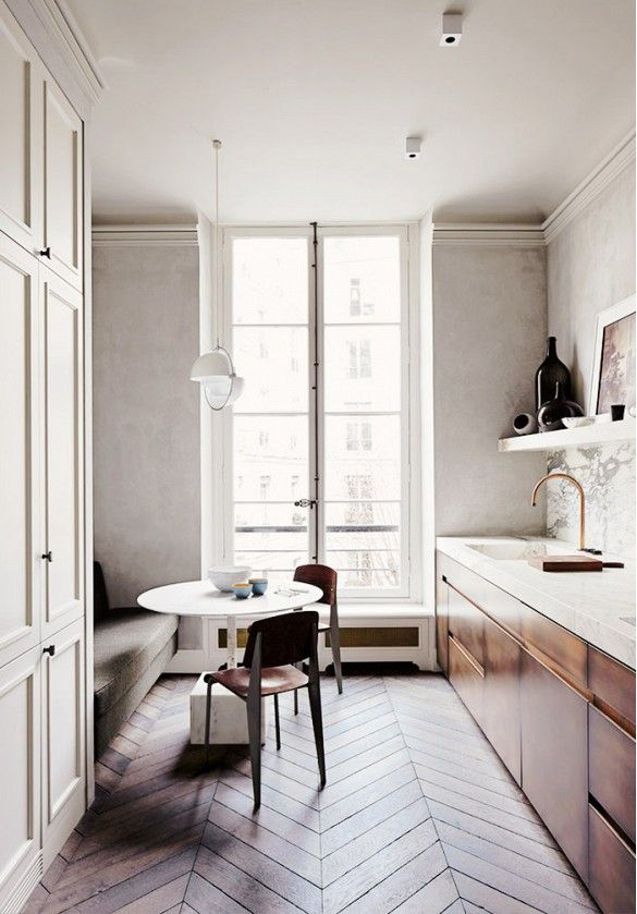 Look We're Loving: Midcentury Polish. In an apartment with traditional bones, modern pieces bring some masculine appeal to a soft, feminine space. A mix of textures in this narrow French kitchen keeps things interesting despite the limited color story.