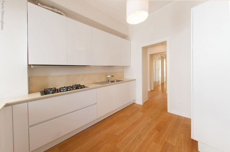 Kitchen: Replacing unused spaces with a new kitchen with direct connection to the living room. Luxury living in bright white home in Rome, Italy | Interior | Exterior | Decore |
