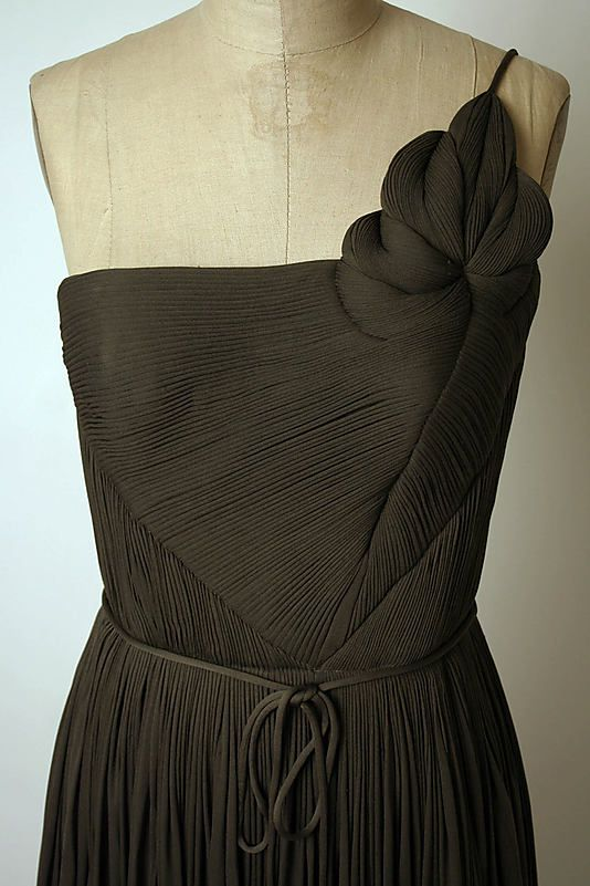 Ensemble (a, b) Madame Grès (Alix Barton)  (French, Paris 1903–1993 Var region)   Manufacturer: (c, d) Massaro (French, founded 1894) Date: 1960s Culture: French Medium: a) silk, nylon; b) silk; c,d) silk, leather. Detail