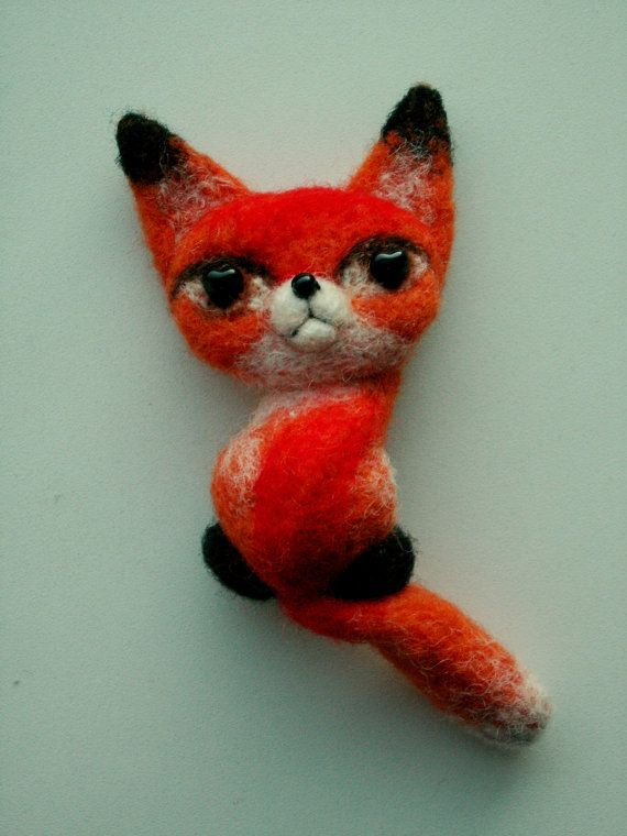 There are lots of other felted animals in our cat city. This little lady fox is one of them. She came to visit her friends and now she is looking