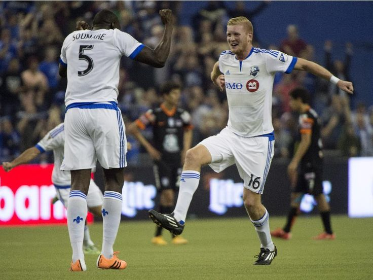 Montreal Impact Bakary Soumare, left, and Calum Mallace celebrate their 1-1 tie against Pachuca FC in CONCACAF soccer action Tuesday, March 3, 2015 in Montreal. The teams tied the two-game aggregate goals series 3-3, but Montreal won on the away goals rule after drawing 2-2 at Pachuca in the first leg last week.