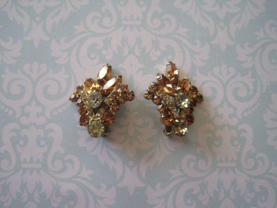 Vintage Topaz Rhinestone Clip-on Earrings  US$12.00 plus shipping!  https://www.etsy.com/ca/listing/210317785/vintage-large-topaz-rhinestone-earrings?ref=shop_home_active_13