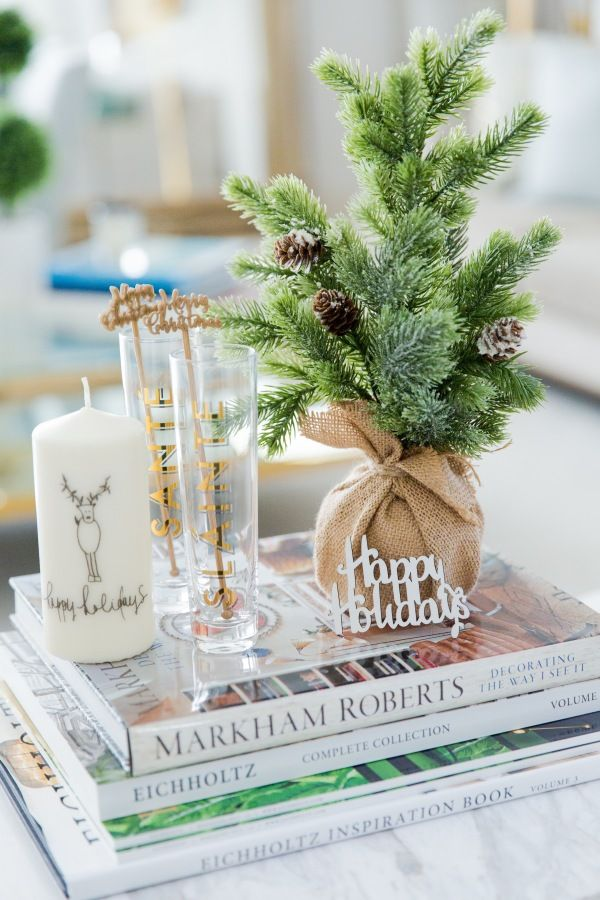 Happy holidays coffee table trinkets: http://www.stylemepretty.com/living/2016/12/06/peek-inside-a-home-thats-decking-the-halls-in-the-most-glamorous-of-ways/ Photography: Yesi Flores - http://www.simplylively.us/