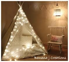 A DIY teepee with twinkle lights for kids room